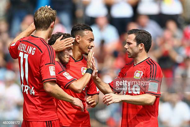 Hakan Calhanoglu celebrates his first goal with Stefan Kiessling Karim Bellarabi and Gonzalo Castro of Leverkusen during the friendly match between...