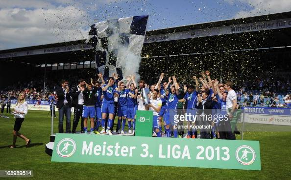 Hakan Calhanoglu celebrates with Karlsruher SC team mates as they receive the trophy after the third Bundesliga match between SV Wehen Wiesbaden and...