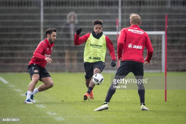 Hakan Calhanoglu Leon Bailey and Julian Brandt of Leverkusen fight for the ball during the training on March 6 2017 in Leverkusen Germany
