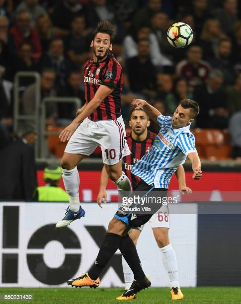 Hakan Calhanoglu of AC Milan and Alberto Grassi of Spal compete for the ball during the Serie A match between AC Milan and Spal at Stadio Giuseppe...