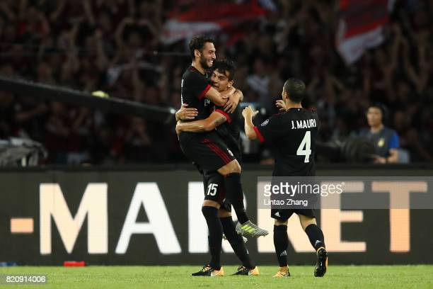 Hakan Calhanoglu of AC Milan celebrates a goal with teammate Jose Mauri and Gustavo Gomez during the 2017 International Champions Cup China match...