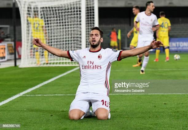 Hakan Calhanoglu of AC Milan celebrates after scoring the 03 goal during the Serie A match between AC Chievo Verona and AC Milan at Stadio...