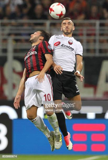 Hakan Calhanoglu of AC Milan competes for the ball with Marjan Radeski of KF Shkendija 79 during the UEFA Europa League Qualifying PlayOffs round...