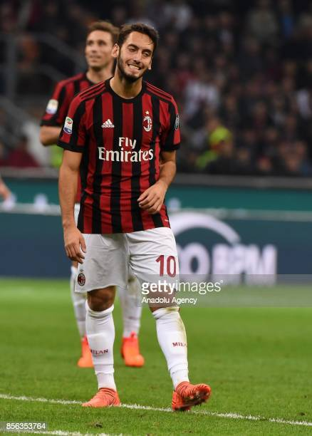 Hakan Calhanoglu of AC Milan gestures during the Serie A 2017/18 match between AC Milan and AS Roma at Stadio Giuseppe Meazza on October 1 2017 in...