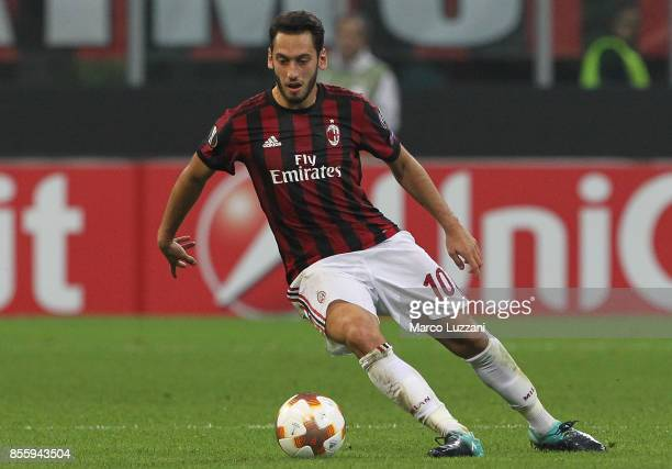 Hakan Calhanoglu of AC Milan gestures during the UEFA Europa League group D match between AC Milan and HNK Rijeka at Stadio Giuseppe Meazza on...