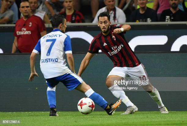 Hakan Calhanoglu of AC Milan in action against Gustavo Vagenin of CS U Craiova during UEFA Europa League Qualifying Round match between AC Milan and...