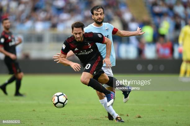 Hakan Calhanoglu of AC Milan in action against Marco Parolo of SS Lazioduring the Serie A soccer match between SS Lazio and AC Milan Stadio Olimpico...