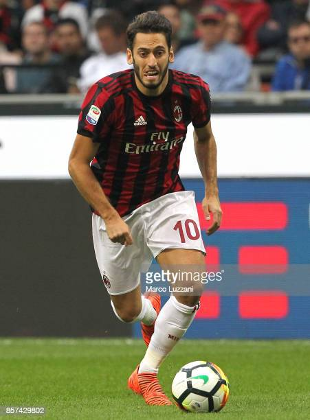 Hakan Calhanoglu of AC Milan in action during the Serie A match between AC Milan and AS Roma at Stadio Giuseppe Meazza on October 1 2017 in Milan...