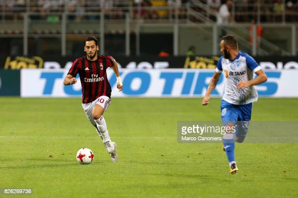 Hakan Calhanoglu of Ac Milan in action during the UEFA Europa League Third Qualifying Round Second Leg match between AC Milan and CSU Craiova AC...