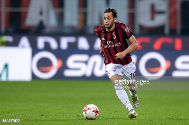 Hakan Calhanoglu of AC Milan in action during the UEFA Europa League Qualifying PlayOffs Round First Leg match between AC Milan and KF Shkendija AC...