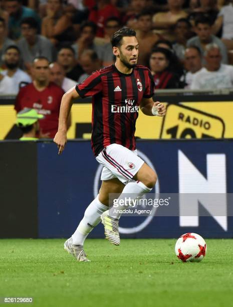 Hakan Calhanoglu of AC Milan in action during UEFA Europa League Qualifying Round match between AC Milan and CS U Craiova at Giuseppe Meazza of San...
