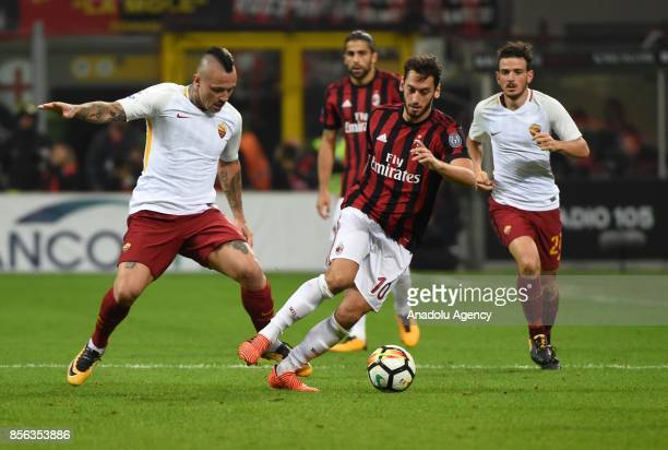 Hakan Calhanoglu of AC Milan is in action against Radja Nainggolan of Roma during the Serie A 2017/18 match between AC Milan and AS Roma at Stadio...
