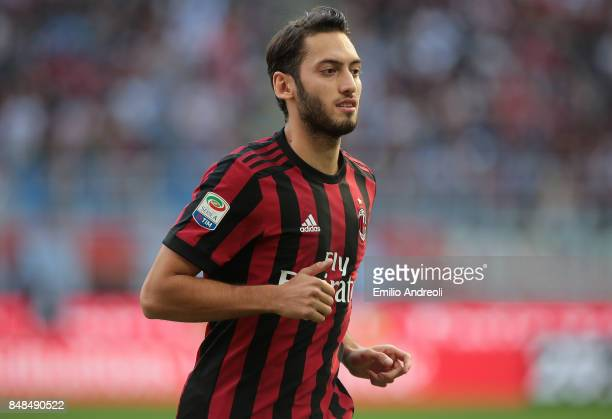 Hakan Calhanoglu of AC Milan looks on during the Serie A match between AC Milan and Udinese Calcio at Stadio Giuseppe Meazza on September 17 2017 in...