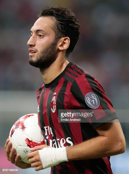 Hakan Calhanoglu of AC Milan looks on during the UEFA Europa League Third Qualifying Round Second Leg match between AC Milan and CSU Craiova at...