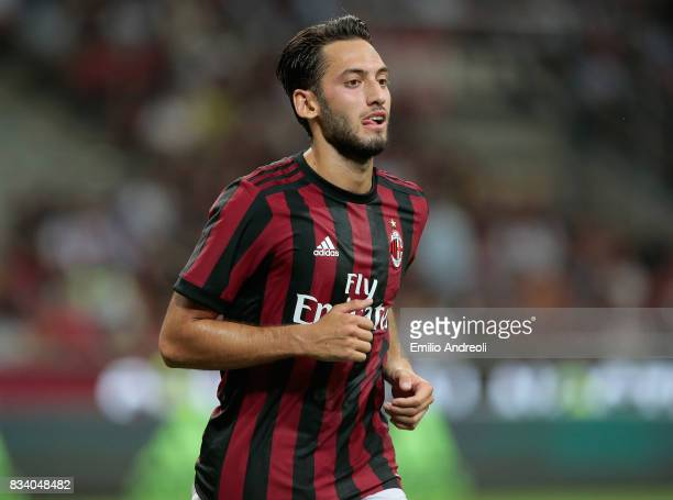 Hakan Calhanoglu of AC Milan looks on during the UEFA Europa League Qualifying PlayOffs round first leg match between AC Milan and KF Shkendija 79 at...