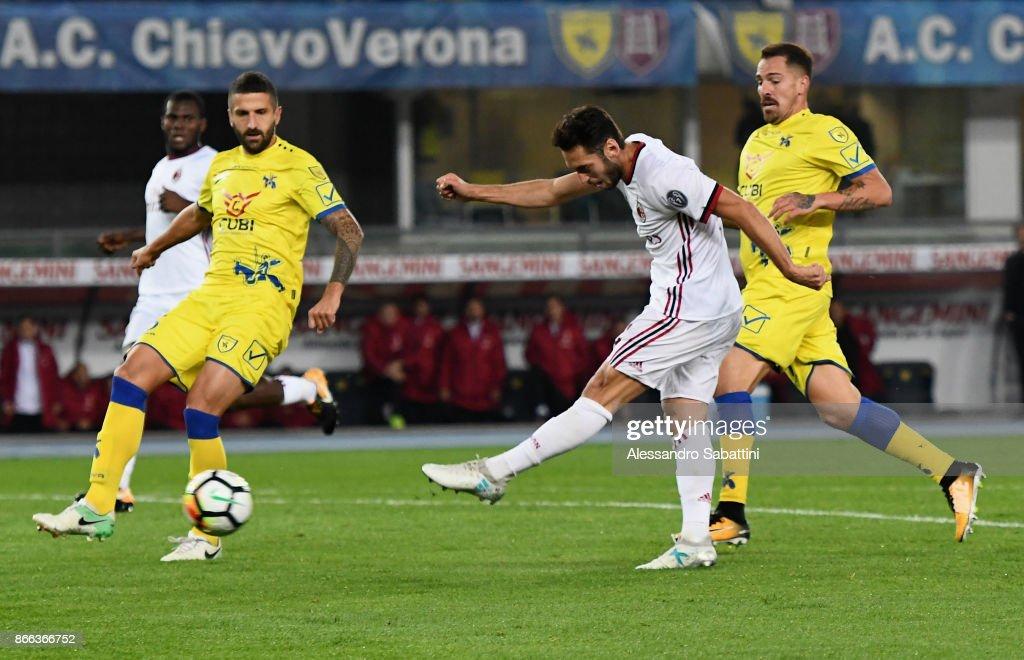 Hakan Calhanoglu of AC Milan scores the 0-3 goal during the Serie A match between AC Chievo Verona and AC Milan at Stadio Marc'Antonio Bentegodi on October 25, 2017 in Verona, Italy.