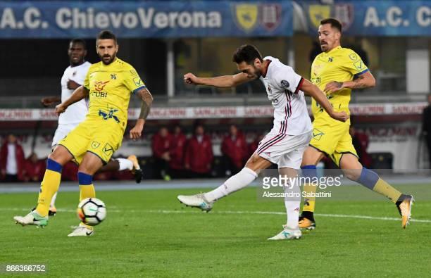 Hakan Calhanoglu of AC Milan scores the 03 goal during the Serie A match between AC Chievo Verona and AC Milan at Stadio Marc'Antonio Bentegodi on...