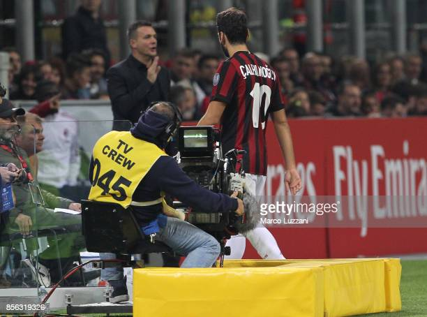 Hakan Calhanoglu of AC Milan walks off after getting a red card during the Serie A match between AC Milan and AS Roma at Stadio Giuseppe Meazza on...