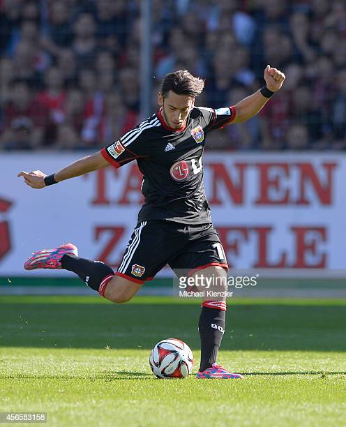 Hakan Calhanoglu of Bayer 04 Leverkusen shoots ball during the Bundesliga match between SC Freiburg and Bayer 04 Leverkusen at Schwarzwald Stadium on...