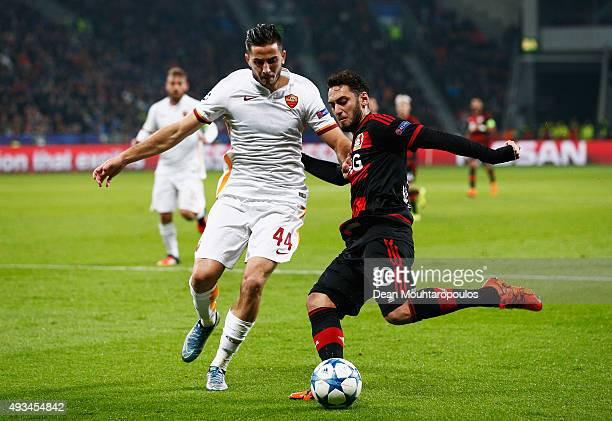 Hakan Calhanoglu of Bayer Levekusen is blocked by Konstantinos Manolas of AS Roma during the UEFA Champions League Group E match between Bayer 04...