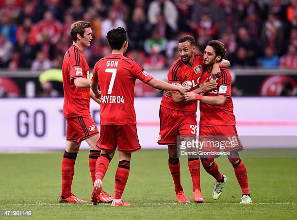 Hakan Calhanoglu of Bayer Leverkusen celebrates as he scores the opening goal during the Bundesliga match between Bayer 04 Leverkusen and FC Bayern...
