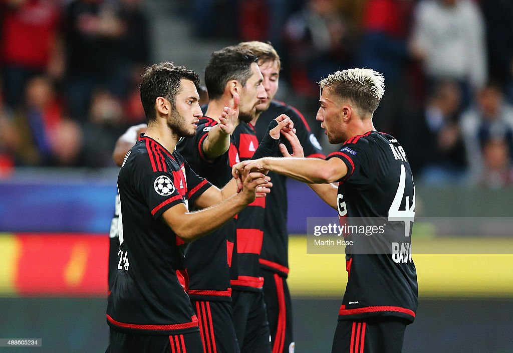 Hakan Calhanoglu (L) of Bayer Leverkusen celebrates scoring his penalty with Kevin Kampl during the UEFA Champions League Group E match between Bayer 04 Leverkusen and FC BATE Borisov at BayArena on September 16, 2015 in Leverkusen, Germany.