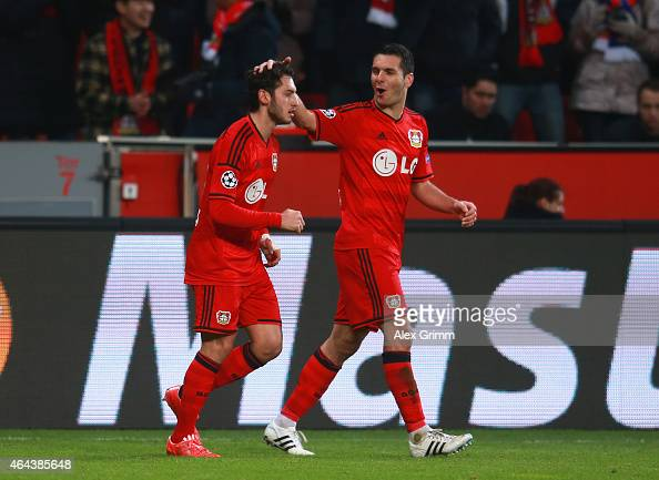 Hakan Calhanoglu of Bayer Leverkusen celebrates scoring the opening goal with Emir Spahic of Bayer Leverkusen during the UEFA Champions League round...