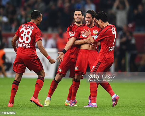 Hakan Calhanoglu of Bayer Leverkusen celebrates with team mates as he scores their second goal during the Bundesliga match between Bayer 04...