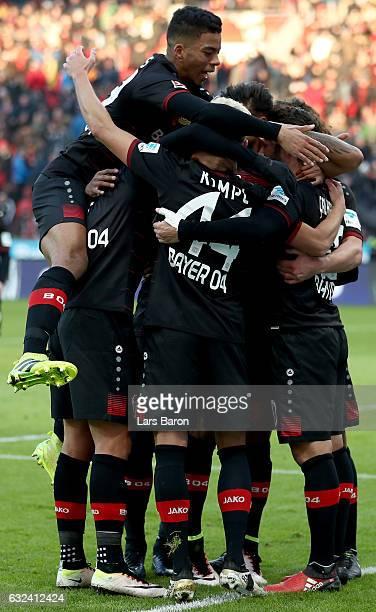 Hakan Calhanoglu of Bayer Leverkusen celebrates with team mates during the Bundesliga match between Bayer 04 Leverkusen and Hertha BSC at BayArena on...