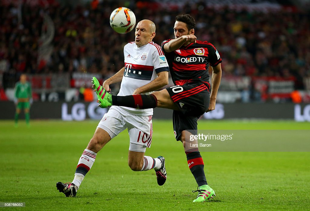 Hakan Calhanoglu of Bayer Leverkusen clears the ball under pressure from <a gi-track='captionPersonalityLinkClicked' href=/galleries/search?phrase=Arjen+Robben&family=editorial&specificpeople=194740 ng-click='$event.stopPropagation()'>Arjen Robben</a> of FC Bayern Muenchen during the Bundesliga match between Bayer Leverkusen and FC Bayern Muenchen at BayArena on February 6, 2016 in Leverkusen, Germany.