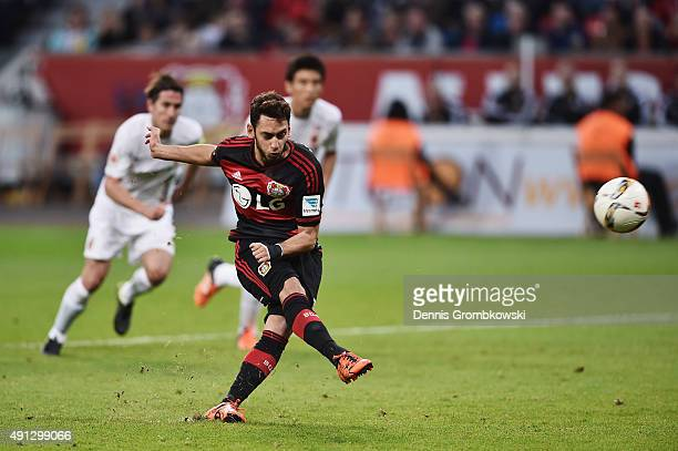 Hakan Calhanoglu of Bayer Leverkusen misses a chance at goal from a penalty during the Bundesliga match between Bayer Leverkusen and FC Augsburg at...