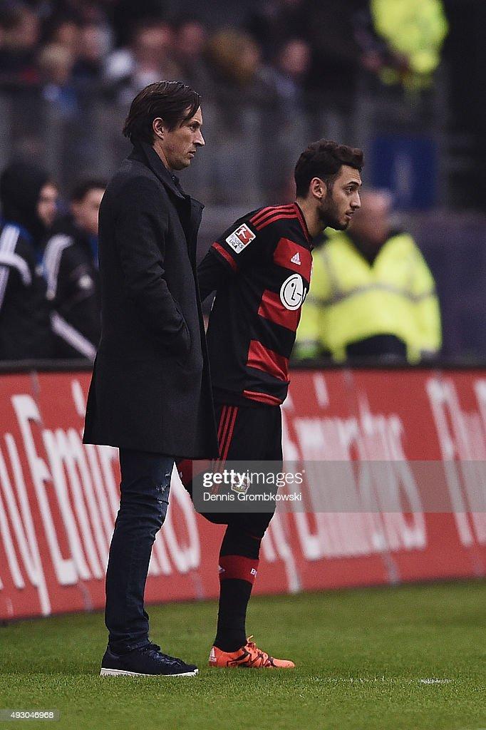 Hakan Calhanoglu of Bayer Leverkusen prepares to enter the pitch during the Bundesliga match between Hamburger SV and Bayer Leverkusen at Volksparkstadion on October 17, 2015 in Hamburg, Germany.