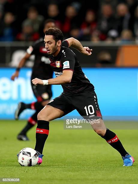 Hakan Calhanoglu of Bayer Leverkusen runs with the ball during the Bundesliga match between Bayer 04 Leverkusen and Borussia Moenchengladbach at...