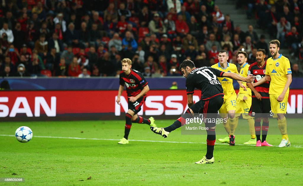 Hakan Calhanoglu of Bayer Leverkusen scores from the penalty spot, his team's fourth goal during the UEFA Champions League Group E match between Bayer 04 Leverkusen and FC BATE Borisov at BayArena on September 16, 2015 in Leverkusen, Germany.