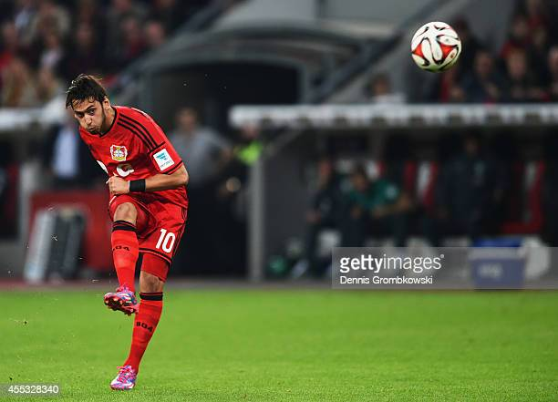 Hakan Calhanoglu of Bayer Leverkusen scores their second goal from a free kick during the Bundesliga match between Bayer 04 Leverkusen and Werder...