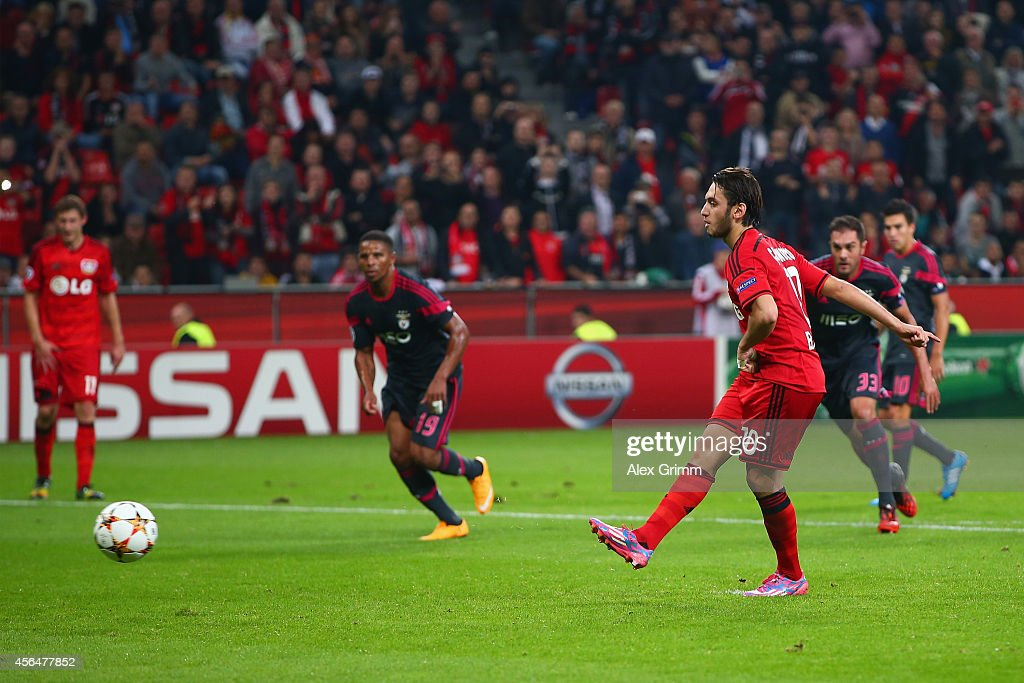 Hakan Calhanoglu of Bayer Leverkusen scores their third goal from the penalty spot during the UEFA Champions League Group C match between Bayer 04...