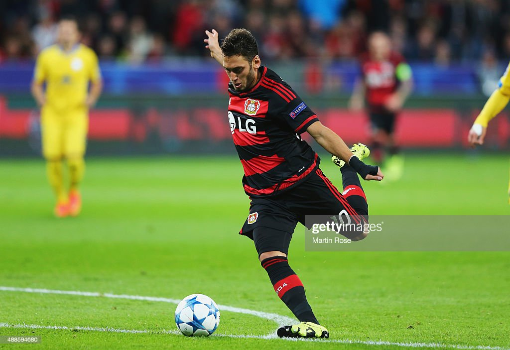 Hakan Calhanoglu of Bayer Leverkusen shoots and scores his team's second goal during the UEFA Champions League Group E match between Bayer 04...