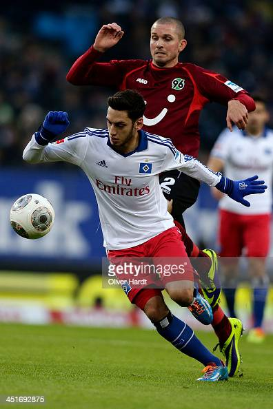 Hakan Calhanoglu of Hamburg and Leon Andreasen of Hannover compete for the ball during the Bundesliga match between Hamburger SV and Hannover 96 at...