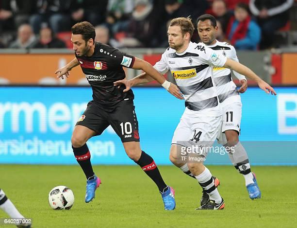 Hakan Calhanoglu of Leverkusen and Tony Jantschke of Moenchengladbach battle for the ball during the Bundesliga match between Bayer 04 Leverkusen and...