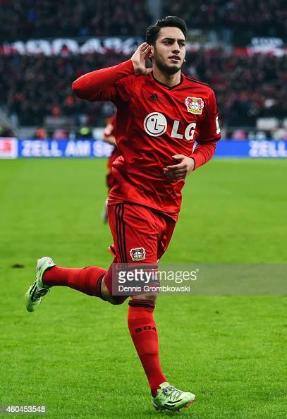 Hakan Calhanoglu of Leverkusen celebrates his team's first goal during the Bundesliga match between Bayer 04 Leverkusen and Borussia Moenchengladbach...