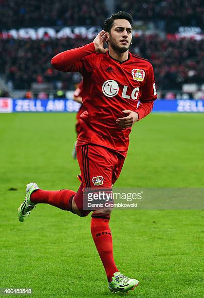Hakan Calhanoglu of Leverkusen celebrates his team's first goal during the Bundesliga match between Bayer 04 Leverkusen and Borussia Moenchengladbach...