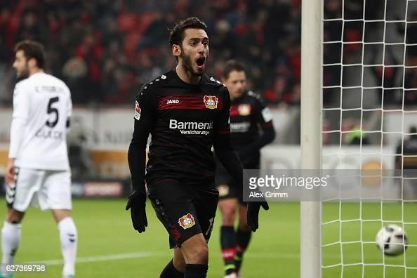 Hakan Calhanoglu of Leverkusen celebrates his team's first goal during the Bundesliga match between Bayer 04 Leverkusen and SC Freiburg at BayArena...