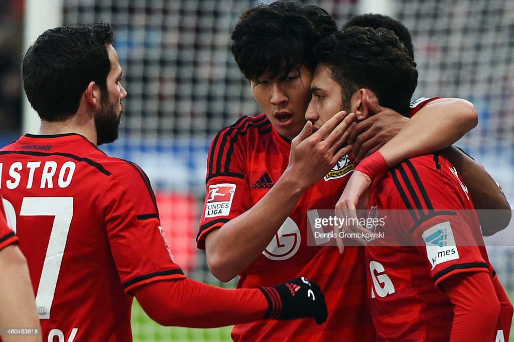 Hakan Calhanoglu of Leverkusen celebrates his team's first goal with team mates <a gi-track='captionPersonalityLinkClicked' href=/galleries/search?phrase=Heung-Min+Son&family=editorial&specificpeople=7118687 ng-click='$event.stopPropagation()'>Heung-Min Son</a> and <a gi-track='captionPersonalityLinkClicked' href=/galleries/search?phrase=Gonzalo+Castro&family=editorial&specificpeople=605388 ng-click='$event.stopPropagation()'>Gonzalo Castro</a> (R-L) during the Bundesliga match between Bayer 04 Leverkusen and Borussia Moenchengladbach at BayArena on December 14, 2014 in Leverkusen, Germany.
