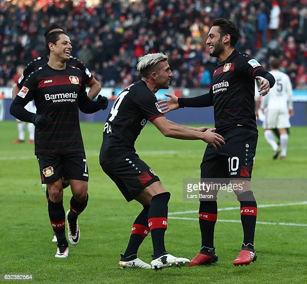 Hakan Calhanoglu of Leverkusen celebrates scoring the penalty goal during the Bundesliga match between Bayer 04 Leverkusen and Hertha BSC at BayArena...