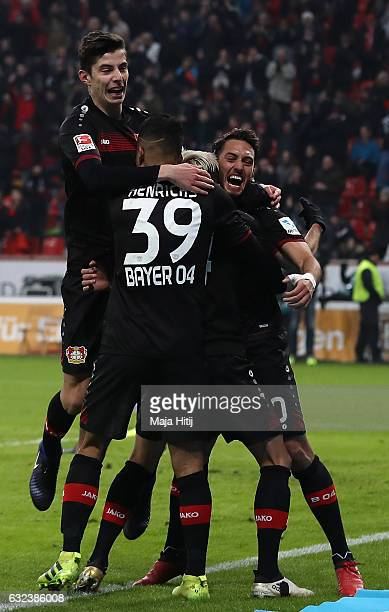 Hakan Calhanoglu of Leverkusen celebrates scoring the third goal with teamates during the Bundesliga match between Bayer 04 Leverkusen and Hertha BSC...