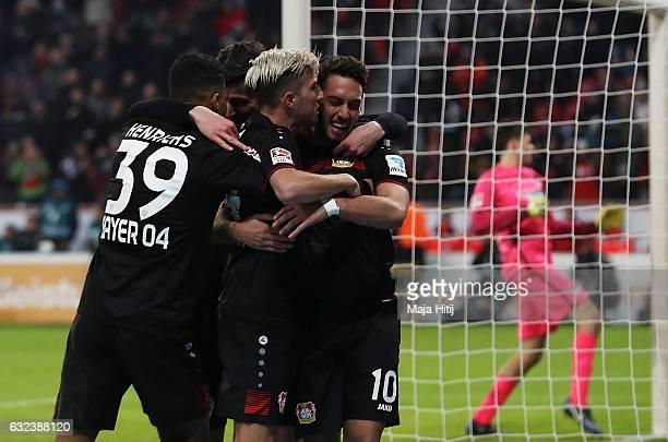 Hakan Calhanoglu of Leverkusen celebrates scoring the third goal with teamates during the Bundesliga match between Bayer 04 Leverkusen and Hertha BSC...