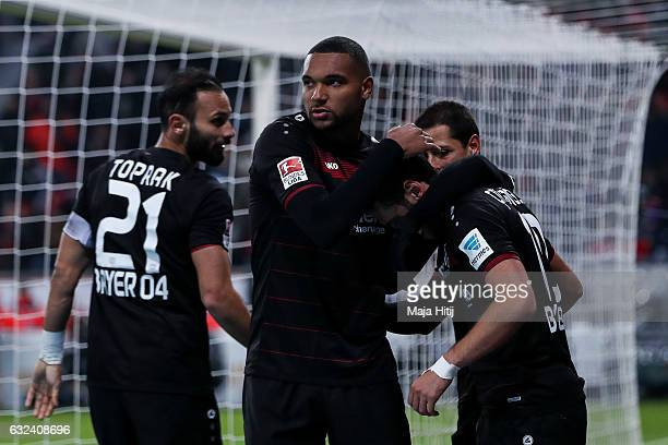 Hakan Calhanoglu of Leverkusen celebrates with his teammates after scoring his team's third goal during the Bundesliga match between Bayer 04...