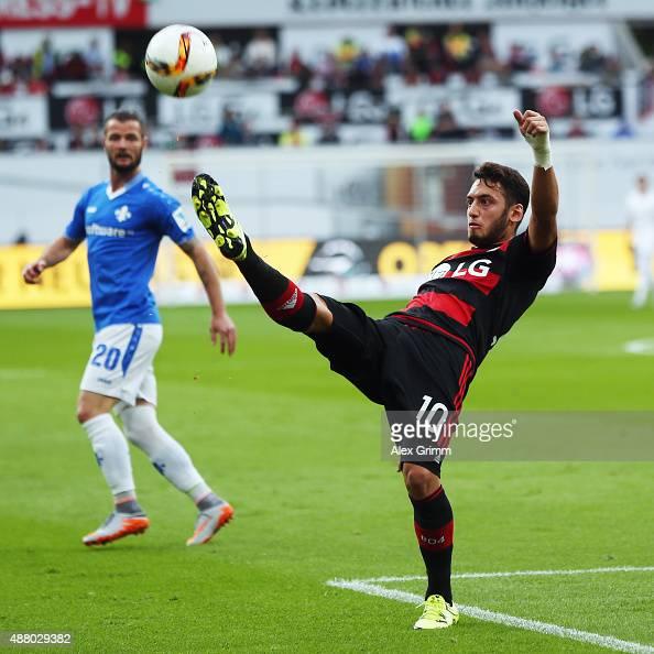Hakan Calhanoglu of Leverkusen clears the ball during the Bundesliga match between Bayer Leverkusen and SV Darmstadt 98 at BayArena on September 12...