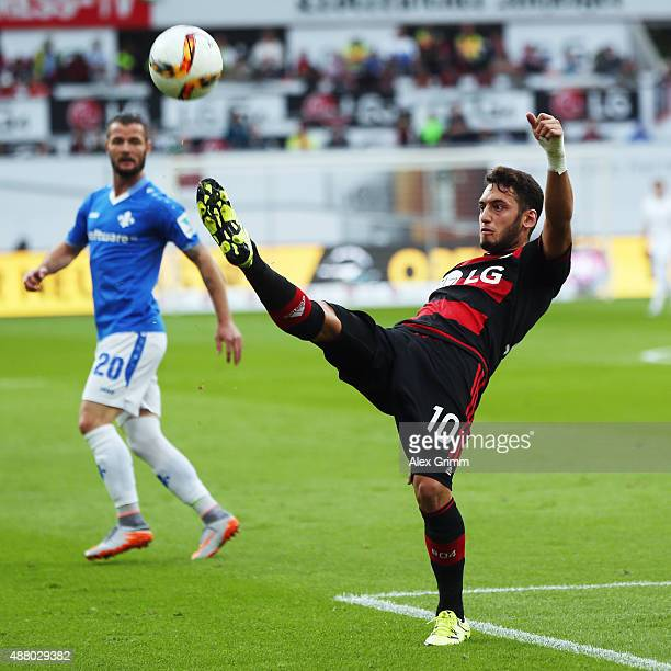 Hakan Calhanoglu of Leverkusen clears the ball during the Bundesliga match between Bayer Leverkusen and SV Darmstadt 98 at BayArena on September 12...
