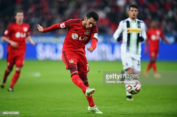 Hakan Calhanoglu of Leverkusen scores his team's first goal during the Bundesliga match between Bayer 04 Leverkusen and Borussia Moenchengladbach at...